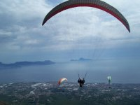 Paragliding flight with a view of Vesuvius