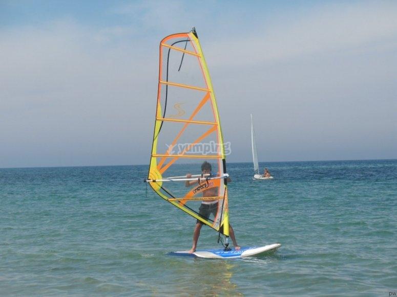 Boy windsurfing