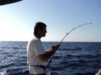 Pescatore esperto a bordo