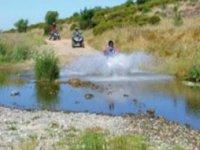 Guadando il rio in quad