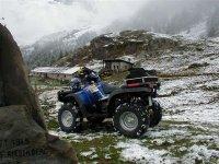 Sulla neve in quad
