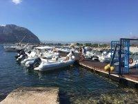 I saw aspettiamo at the port of Mondello