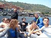 In a rubber dinghy towards diving