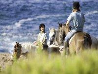 A cavallo con una guida