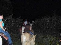 at night on horseback