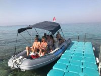 By rubber boat