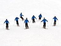 Teachers teach skiing