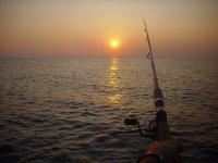 Sport fishing during a breathtaking sunrise