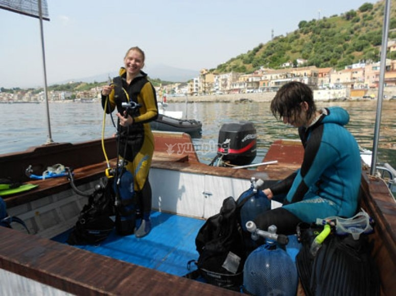 Divers with wetsuits