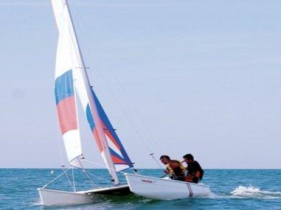 Scirocco Windsurfing School Escursione in Barca