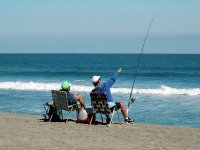 comfortably on the beach fishing
