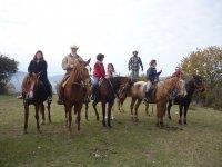 Foto di gruppo a cavallo