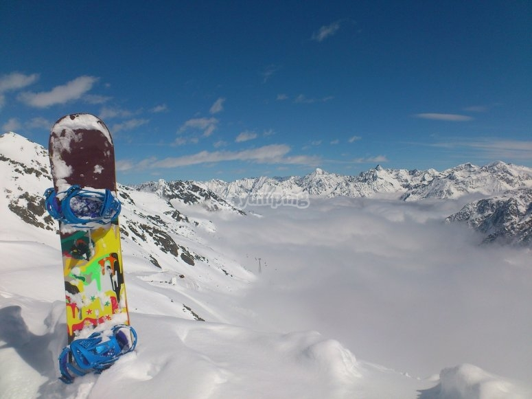 Snowboard in the clouds