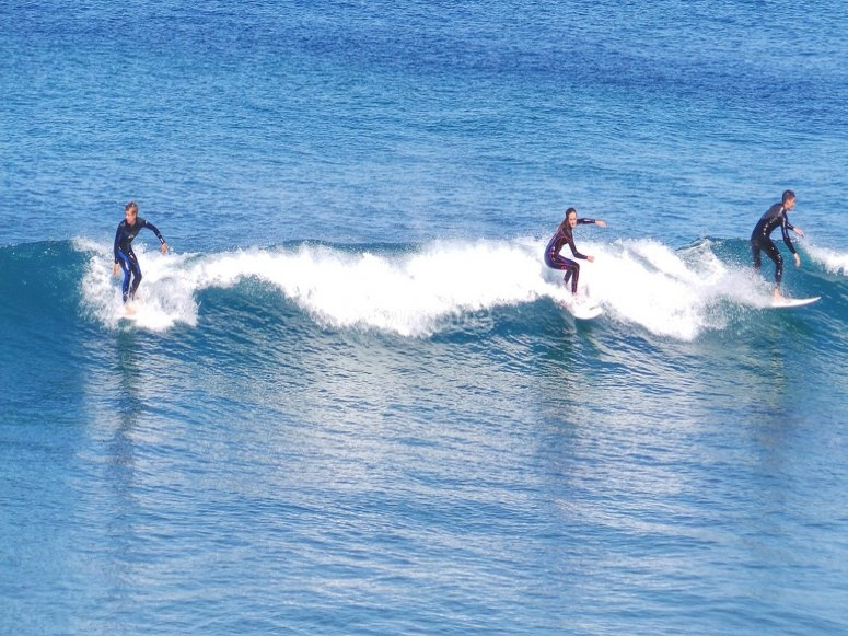 Surfing the waves together