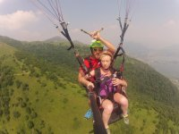 Tandem paragliding flight in Suello with photo
