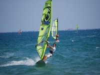 Boy on windsurfing
