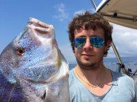 Pescatore sulla barca
