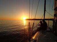 In the boat at sunset