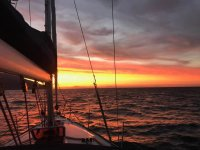Sunset on a sailing boat.