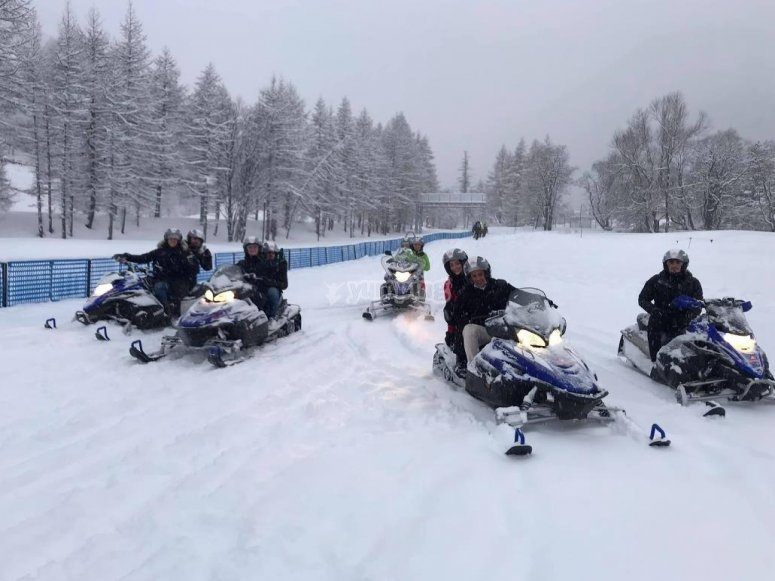 all together on a snowmobile