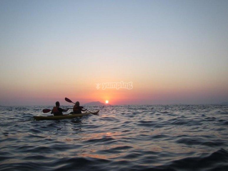 In kayak at sunset