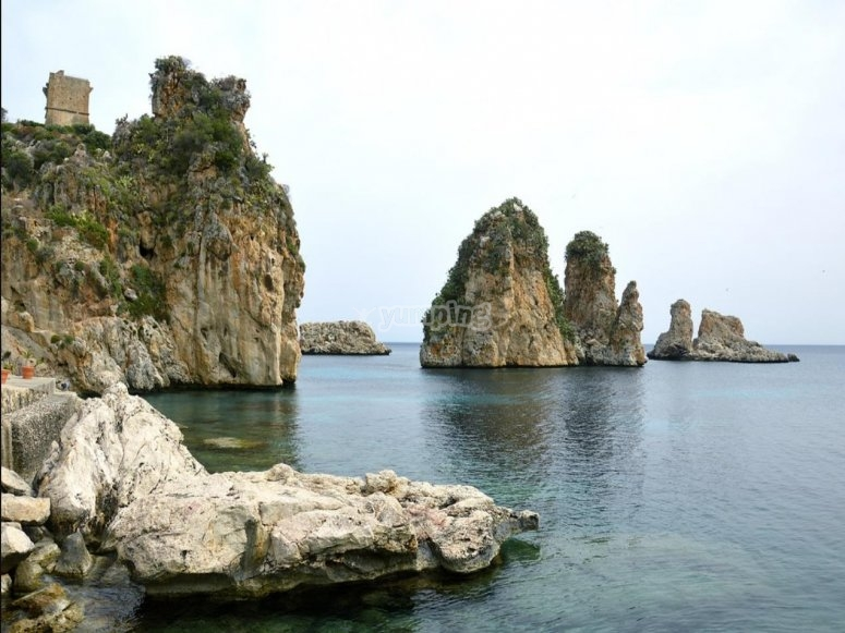 arrive by jet ski to the stacks of Scopello