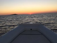 In dinghy at sunset