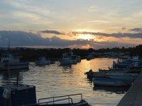 Il tramonto dal porto