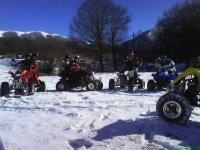 In quad sulla neve
