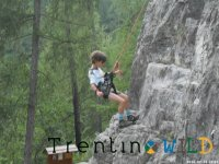 Young people struggling with climbing