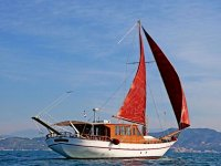 gulet with red sail